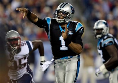 Carolina Panthers quarterback Cam Newton (1) passes against the New England Patriots in the first half of an NFL preseason football game Friday, Aug. 22, 2014, in Foxborough, Mass. (AP Photo/Charles Krupa)