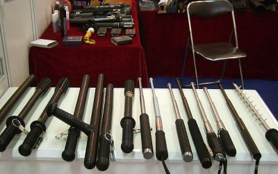 Side handled and telescopic batons and spike batons are displayed at a police equipment exhibition (Amnesty/AP)