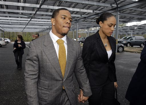 "In this May 1, 2014, file photo, Baltimore Ravens football player  Ray Rice holds hands with his wife, Janay Palmer, as they arrive at Atlantic County Criminal Courthouse in Mays Landing, N.J. Banter by two ""Fox & Friends"" hosts about video showing Rice hitting his then future wife is under fire. The hosts, Brian Kilmeade and Steve Doocey, made their on-air comments Monday, Sept. 8, 2014, while discussing newly released elevator video showing Rice hitting Janay Palmer in February. (AP Photo/Mel Evans, File)"