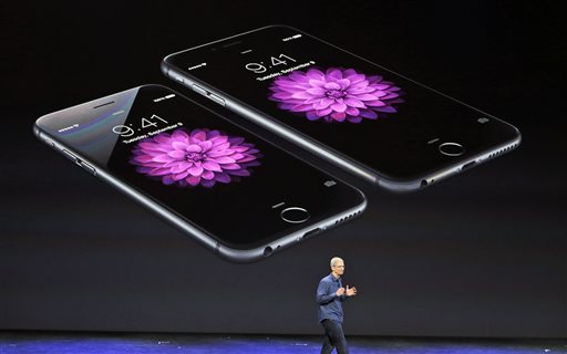 Apple CEO Tim Cook discusses the new iPhone 6 and iPhone 6 plus on Tuesday, Sept. 9, 2014, in Cupertino, Calif. The iPhone 6 will have a screen measuring 4.7 inches, while the iPhone 6 Plus will be 5.5 inches. (AP Photo/Marcio Jose Sanchez)