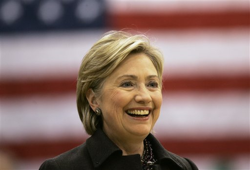 "In this Dec. 31, 2007, file photo, then-Democratic presidential hopeful Sen. Hillary Rodham Clinton, D-N.Y., smiles while speaking at a campaign stop at Muscatine West Middle School in Muscatine, Iowa. Clinton last left Iowa on an ""excruciating"" night, the beginning of the end of her White House campaign. She returns for the first time this weekend, not quite yet running for president, but sure to hear cheers from a crowd of Democrats hoping she will. (AP Photo/Jeff Chiu, File)"