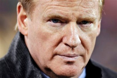 """In this Feb. 2, 2014, file photo, NFL Commissioner Roger Goodell takes the field before the NFL Super Bowl XLVIII football game between the Seattle Seahawks and the Denver Broncos in East Rutherford, N.J.  A law enforcement official says he sent a video of Ray Rice punching his then-fiancee to an NFL employee five months ago, while league executives have insisted they didn't see the violent images until they were published this week. The person played The Associated Press a 12-second voicemail from an NFL office number confirming the video arrived on April 9. A female voice expresses thanks for providing the video and says: """"You're right. It's terrible."""" Goodell sent a memo on Wednesday, Sept. 10, 2014, to the 32 teams reiterating that the NFL never saw the video until Monday, Sept. 8. (AP Photo/Ben Margot, File)"""