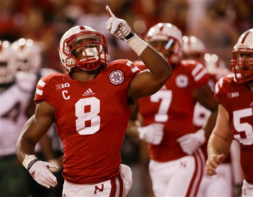 Nebraska running back Ameer Abdullah (8) reacts after scoring a touchdown against Miami in the second half of an NCAA college football game in Lincoln, Neb., Saturday, Sept. 20, 2014. Abdullah ran for 229 yards to lead a punishing ground game, and No. 24 Nebraska celebrated the 20th anniversary of its 1994 national championship team with an emotional 41-31 victory over Miami. (AP Photo/Nati Harnik)