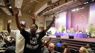 Many residents at a Ferguson City Council meeting expressed displeasure over details of a citizens review board proposed to monitor the Police Department. (Jeff Roberson / Associated Press)