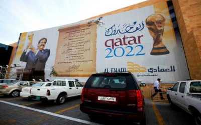 A banner featuring the Qatar 2022 World Cup hangs on a building in Doha, Qatar, Jan. 6, 2011. (Kin Cheung/AP Photo)