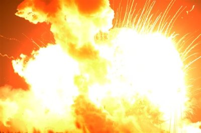 An unmanned Orbital Sciences Corp.'s Antares rocket explodes shortly after takeoff at Wallops Flight Facility on Wallops Island, Va. on Tuesday, Oct. 28, 2014. No injuries were reported following the first catastrophic launch in NASA's commercial spaceflight effort. (AP Photo/Eastern Shore News, Jay Diem)