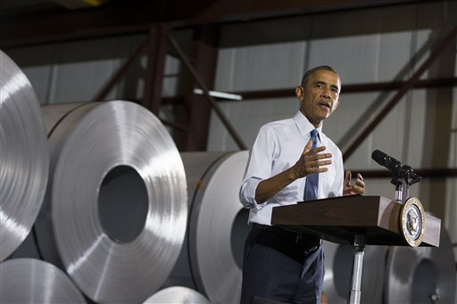 President Barack Obama speaks at Millennium Steel Service in Princeton, Ind., Friday, Oct. 3, 2014, to discuss the economy as part of Manufacturing Day. Boosted by the lowest jobless rate in six years, the president on Friday heralded September's hiring rate as the longest uninterrupted stretch of private sector job growth in U.S. history and boasted that the country is surpassing combined job creation in other advanced economies. (AP Photo/Evan Vucci)