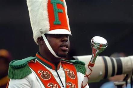 FILE - In this Nov. 19, 2011 file photo, Robert Champion, a drum major in Florida A&M University's Marching 100 band, performs during halftime of a football game in Orlando, Fla. The trial for four band members charged in the hazing death of Champion begins Monday, Oct. 27, 2014 in Orlando, Fla. (AP Photo/The Tampa Tribune, Joseph Brown III, File)