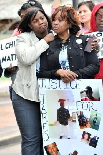 Zena Elam embraces her cousin Sebrina Elam during the Mother's March for Justice rally in front of the Buzz Westfall County Government Center in Clayton. About 300 supporters marched against violence in the community. Sebrina's son Jared Elam was found fatally shot in a field near the 4200 block of Obear in Sept. (Wiley Price/St. Louis American)