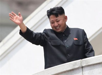"In this July 27, 2013 photo, North Korean leader Kim Jong Un waves to war veterans during a mass military parade celebrating the 60th anniversary of the Korean War armistice in Pyongyang, North Korea. From ""Saturday Night Live"" on Oct. 11, 2014 spoofs to the wild theories of journalists across the globe trying to parse his five-week absence from the public eye, the 30-something leader of North Korea has captured as many headlines as he did when he threatened to nuke his enemies last year. This bewildering ability to command attention by doing nothing says a lot about the North's total mastery of a propaganda apparatus that puts Kim at the center of everything. (AP Photo/Wong Maye-E, File)"