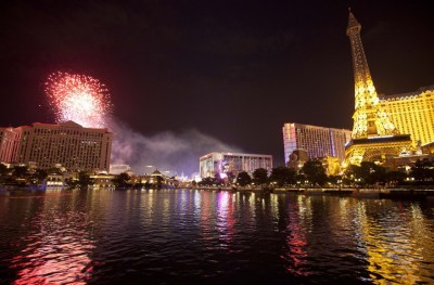 Light from Independence Day weekend fireworks is reflected in the water in front of the Bellagio Hotel in Las Vegas, July 3, 2011. (AP Photo)