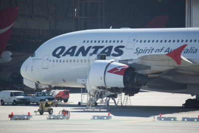 In this Nov. 13, 2010 photo, a Qantas A380 is inspected on the tarmac at Los Angeles International Airport in Los Angeles. (AP Photo/James Aron)