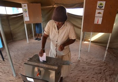 A voter casts her ballot at a polling station in Gaberone, Friday, Oct. 24, 2014. Electoral officials say that voting has begun without incident where analysts believe the ruling party will win despite growing discontent in urban areas. (AP Photo)