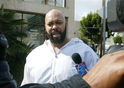 "In this Feb. 26, 2003 file photo, rap music mogul Marion ""Suge"" Knight walks out of the Los Angeles County jail, in Los Angeles.  Los Angeles prosecutors say Knight and comedian Katt Williams were arrested and charged with one count of robbery on Wednesday, Oct. 29, 2014, after a paparazzo reported the men stole her camera in Beverly Hills on Sept. 5, 2014. (AP Photo/Damian Dovarganes, File)"
