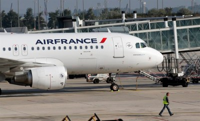 An Air France plane is parked on the tarmac at Paris Charles de Gaulle Airport in Roissy, near Paris, Monday, Sept. 15, 2014. (Christophe Ena/The Canadian Press/AP)