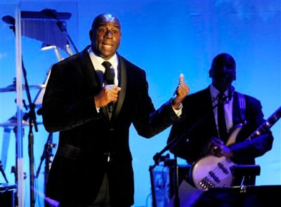 "In this Oct. 11, 2014, file photo, Earvin ""Magic"" Johnson addresses the audience after receiving the Brass Ring Award for his humanitarian efforts at the 2014 Carousel of Hope Ball at the Beverly Hilton Hotel in Beverly Hills, Calif. The retired Los Angeles Laker became famous for dishing out assists to his teammates during his Hall of Fame basketball career. Now, as an entrepreneur focused on minority markets, he says he is ready to help Silicon Valley hire more blacks and Latinos to diversify the technology industry's largely white and Asian workforce. (Photo by Chris Pizzello/Invision/AP, File)"