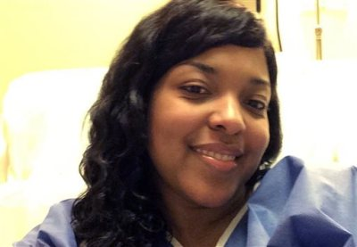 This Oct. 21, 2014, file photo, provided by Amber Vinson, shows Vinson at Emory University Hospital in Atlanta. Vinson, a Dallas nurse who was being treated for Ebola, will attend a news conference, Tuesday, Oct. 28, 2014, to discuss her discharge from the hospital after tests showed she's virus-free. (AP Photo/Amber Vinson, File)