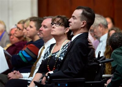 Brandon Coats, a quadriplegic medical marijuana patient who was fired by the Dish Network after failing a drug test more than four years ago, right, waits for the proceedings to begin with his mother, Donna Scharfenberg, at the Colorado Supreme Court in Denver on Tuesday, Sept. 30, 2014. Coats' case highlights the clash between state laws that are increasingly accepting of marijuana use and employers' drug-free policies that won't tolerate it. (AP Photo/The Denver Post, Kathryn Scott Osler, Pool)