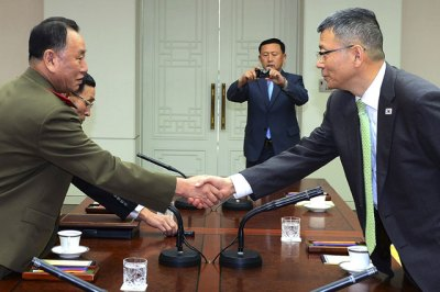 North Korean delegation chief Kim Yong Chol (left) shakes hands with his South Korean counterpart, Deputy Minister for National Defence Policy Ryu Je-seung during a meeting at the border village of Panmunjom, South Korea. (AP Photo)