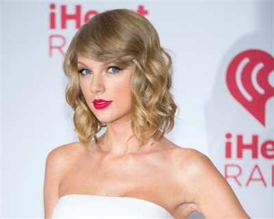 "In this Sept. 19, 2014 file photo, Taylor Swift arrives at the iHeart Radio Music Festival in Las Vegas. The music streaming service Spotify is no longer offering Swift songs at her request, setting up a battle between the industry's most popular artist and the leading purveyor of a new music distribution system. Spotify, which pulled Swift's songs on Monday, Nov. 3, 2014, said that ""we hope she'll change her mind and join us in building a new music economy that works for everyone.""  (Photo by Andrew Estey/Invision/AP, File)"