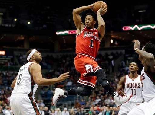 9bc31d3934ea Chicago Bulls  Derrick Rose looks to pass in traffic during the first half  of an NBA basketball game against the Milwaukee Bucks Wednesday