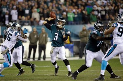 Philadelphia Eagles' Mark Sanchez passes during the first half of an NFL football game against the Carolina Panthers, Monday, Nov. 10, 2014, in Philadelphia. (AP Photo/Matt Rourke)