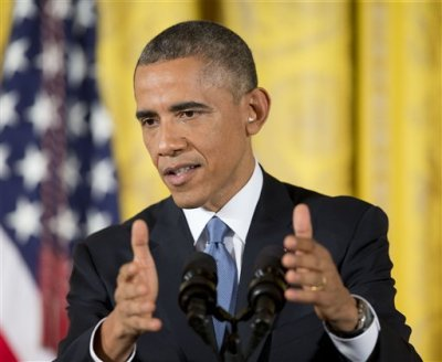 President Barack Obama gestures as he speaks during a news conference in the East Room of the White House, on Wednesday, Nov. 5, 2014, in Washington.  Obama spoke the day after midterm elections, in which his party suffered heavy losses and Republicans seized the Senate. (AP Photo/Pablo Martinez Monsivais)