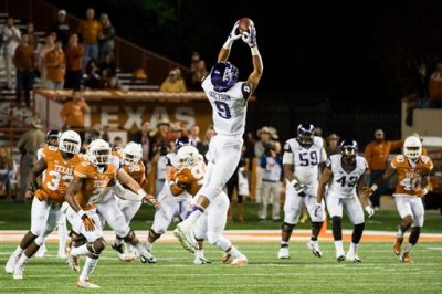 TCU's Josh Doctson (9) catches a pass during the first half of an NCAA college football game against Texas, Thursday, Nov. 27, 2014, in Austin, Texas. (AP Photo/Ashley Landis)