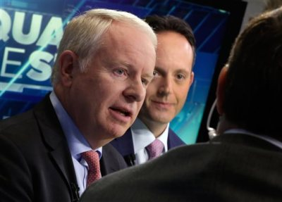 "In this Nov. 17, 2014 file photo, Allergan CEO David Pyott, left, and Actavis CEO Brenton Saunders, are interviewed on the floor of the New York Stock Exchange. Pyott is set to rake in an estimated $100 million in ""golden parachute"" payments, according to a study done by pay-tracking firm Equilar at the request of The Associated Press. (AP Photo/Richard Drew)"