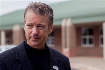 U.S. Sen. Rand Paul, R-Ky., speaks to reporters after voting at Briarwood Elementary School in Bowling Green, Ky., on Election Day Tuesday, Nov. 4, 2014. (AP Photo/The Daily News, Austin Anthony)