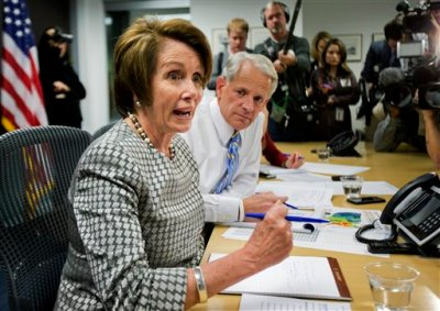 House Minority Leader Nancy Pelosi of Calif., left, and Rep. Steve Israel, D-N.Y., chairman of the Democratic Congressional Campaign Committee (DCCC), receive updates of the election day information from Greg Jackson, field director of DCCC at the Democratic Party headquarters in Washington, Tuesday, Nov. 4, 2014. (AP Photo/Manuel Balce Ceneta)