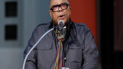 "Music producer Quincy Jones speaks during the hand and footprint ceremony honoring musician Michael Jackson in front of Grauman's Chinese Theatre in Los Angeles, Thursday, Jan. 26, 2012. The ceremony was held to celebrate the ""Michael Jackson The Immortal World Tour"" by Cirque du Soleil. (AP Photo/Matt Sayles)"