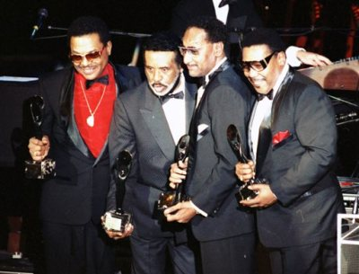 "In this Jan. 1990 file photo, the Four Tops, from left, Renaldo ""Obie"" Benson; Levi Stubbs; Abdul ""Duke"" Fakir, and Lawrence Payton in New York. Surviving members of The Four Tops and The Temptations will play the Palace Theatre together for seven shows between Dec. 29-Jan. 4. Tickets from $52-$142 go on sale Nov. 14. (AP Photo/Ron Frehm, File)"