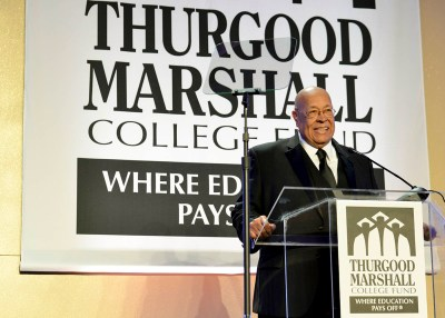"""Joshua Smith, the chairman and managing partner at the Coaching Group, LLC accepts the """"HBCU Alumnus of the Year Award"""" at the recent 26th Annual TMCF Awards Gala. (Freddie Allen/NNPA)"""