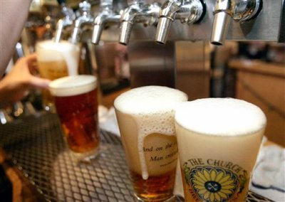 In this June 6, 2008 file photo, a row of freshly poured draft beers are seen in Pittsburgh. (AP Photo/Keith Srakocic, File)