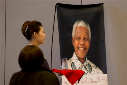 A banner featuring the late South African President Nelson Mandela is displayed at an auditorium where current South Africa President Jacob Zuma is delivering a speech in Tsinghua University in Beijing, China, Friday, Dec. 5, 2014. Zuma is in Beijing on a state visit focused on economic relations, including possible Chinese investment in South Africa's nuclear power sector. (AP Photo/Ng Han Guan)