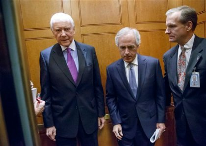 Sen. Orrin Hatch, R-Utah, left, and Sen. Bob Corker, R-Tenn., center, take an elevator to the Senate on Capitol Hill in Washington, Tuesday, Dec. 9, 2014, as Senate Intelligence Committee Chair Sen. Dianne Feinstein, D-Calif., was scheduled to release a report on the CIA's harsh interrogation techniques at secret overseas facilities after the 9/11 terror attacks.  (AP Photo/J. Scott Applewhite)