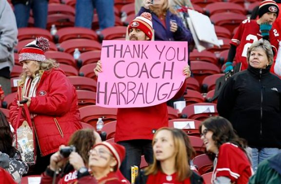 A San Francisco 49ers fan holds up a sign for head coach Jim Harbaugh after an NFL football game between the 49ers and the Arizona Cardinals in Santa Clara, Calif., Sunday, Dec. 28, 2014. The 49ers won 20-17. (AP Photo/Tony Avelar)