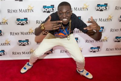 In this Oct. 30, 2014 file photo, Bobby Shmurda arrives at Power 105.1's Powerhouse 2014 at Barclays Center in Brooklyn, New York. Shmurda whose real name is Ackquille Pollard has been arrested in New York City in a gun and narcotics investigation. Authorities said Wednesday, Dec. 17, 2014, that he was apprehended after leaving a Manhattan recording studio. Several others were also taken into custody. (Photo by Scott Roth/Invision/AP, File)