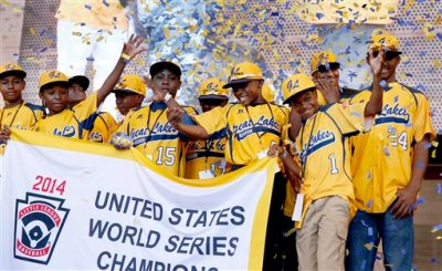 """In this Aug. 27, 2014, file photo, members of the Jackie Robinson West All Stars Little League baseball team participate in a rally celebrating the team's U.S. Little League Championship in Chicago. Little League International said it is confident that Chicago's national championship Little League team did not violate """"residency regulations"""" after investigating allegations that the team added top suburban players to make it stronger. The allegations made by Chris Janes of the Evergreen Park Athletic Association were first reported Tuesday, Dec. 16 in DNAinfo.com. (AP Photo/Charles Rex Arbogast, File)"""
