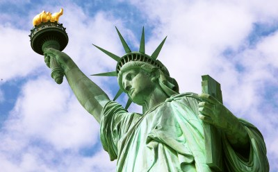 For many immigrants to New York, the Statue of Liberty's torch was the first image of America they saw on the horizon. (AP Images)