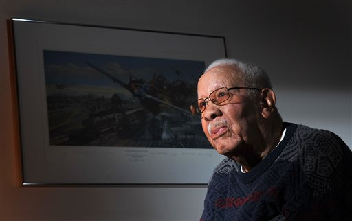 In this Feb. 14, 2012 photo, Lowell C. Steward, 92, poses for a photo, in Oxnard, Calif. Steward, a former member of the Tuskegee Airmen who flew nearly 200 missions over Europe during World War II, died Wednesday, Dec. 17, 2014, in California. He was 95. (AP Photo/The Ventura County Star, Joseph A. Garcia)