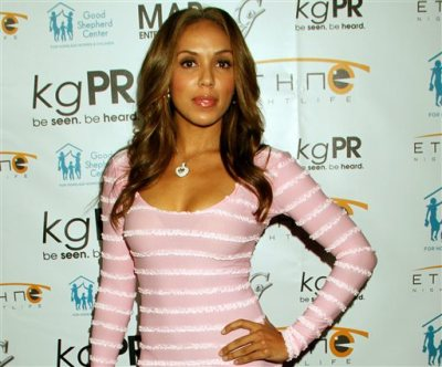 In this Dec. 6, 2012 file photo, Stephanie Moseley attends Good Shepherd Center for Homeless Women & Children Holiday Toy Drive at Crocker Club in Los Angeles. Los Angeles police say 34-year-old rapper Earl Warren Hayes apparently shot and killed his wife Moseley and himself at a Los Angeles apartment. Police say the bodies were discovered Monday morning, Dec. 8, 2014. (Photo by Arnold Turner/Invision/AP, File)