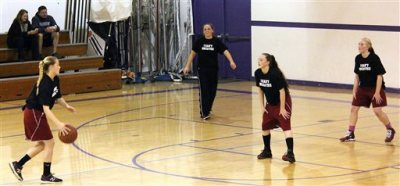 """This photo provided by the Fort Bragg Advocate-News shows Mendocino High School girls basketball wearing the """"I Can't Breathe"""" T-shirts before a recent game.  A high school basketball tournament on the Northern California coast has become the latest flashpoint in the ongoing protests over police killings of unarmed black men after a school was disinvited because of concerns its players would wear T-shirts printed with the words """"I Can't Breathe"""" during warmups. The athletic director at Fort Bragg High School informed his counterpart at Mendocino High School this week that neither the boys nor girls team would be allowed to participate in the three-day tournament hosted by Fort Bragg High starting Monday, Mendocino Unified School District Superintendent Jason Morse said. (AP Photo/Fort Bragg Advocate-News, Chris Calder)"""