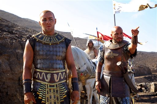 """This image released by 20th Century Fox shows Joel Edgerton, left, and Dar Salim in a scene from """"Exodus: Gods and Kings.""""  (AP Photo/20th Century Fox, Kerry Brown)"""