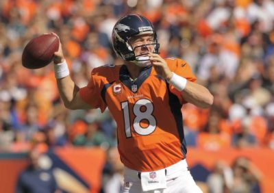 Denver Broncos quarterback Peyton Manning (18) passes the ball in the first half of a game against the Philadelphia Eagles on Sept. 29, 2013 (AP Photo)