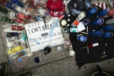 On July 19, a memorial for Eric Garner rests on the pavement near the site of his death in Staten Island. (John Minchillo/AP)