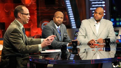 Ernie Johnson, left, Kenny Smith, center, and Charles Barkley in the TNT studios. (AP Photo/Erik S. Lesser)