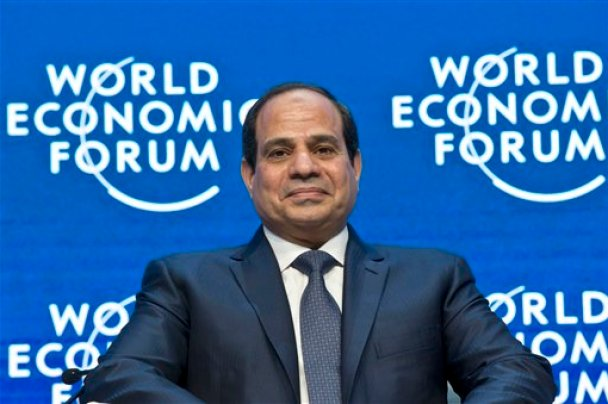 """Egyptian President Abdel-Fattah el-Sissi listens to the opening remarks of the panel """"Egypt in the World"""" at the World Economic Forum in Davos, Switzerland, Thursday, Jan. 22, 2015. The meeting runs from Jan. 21 through Jan. 24. (AP Photo/Michel Euler)"""