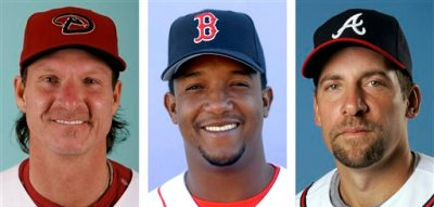 From left are Arizona Diamondbacks' Randy Johnson in 2008, Boston Red Sox' Pedro Martinez in 2003 and Atlanta Braves' John Smoltz in 2008. Randy Johnson, Pedro Martinez and John Smoltz are the leading newcomers on baseball's Hall of Fame ballot when voting is announced Tuesday, Jan. 6, 2014. (AP Photo/File)